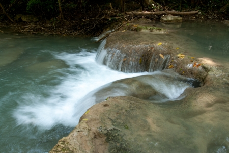 Water fall in spring season located in deep rain forest jungle,Thailand photo