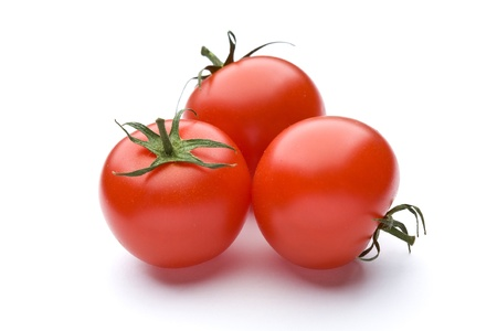 Ripe red tomato of the white back Stock Photo