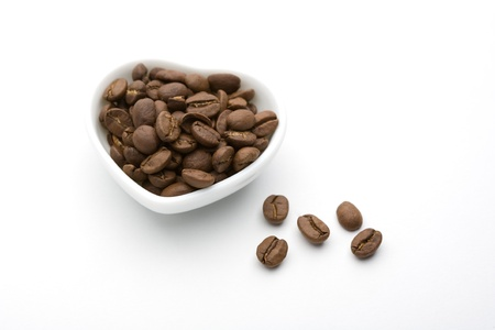 A plate and coffee beans of white heart photo