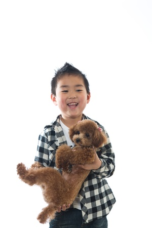 The child who holds a dog Stock Photo - 13153108