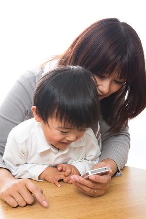 Parent and child who play with a smart phone Stock Photo - 13152232