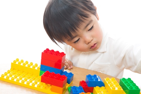 The child who plays in Lego Stock Photo