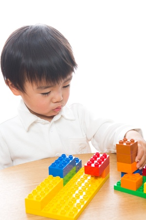 The child who plays in Lego photo