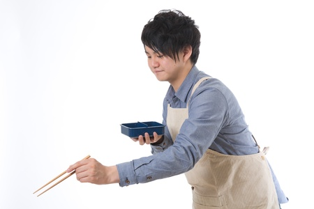 The young man who cooks a lunch Stock Photo - 13398034