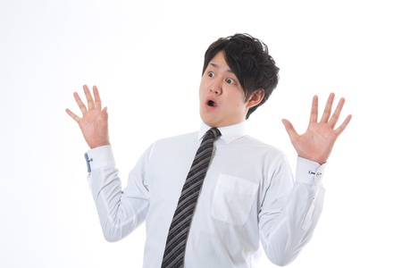 The young businessman who is surprised photo