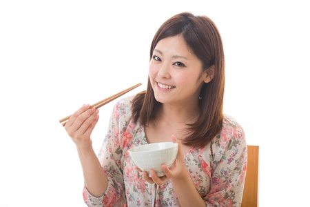 The young woman who eats Stock Photo - 13825383