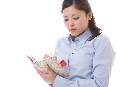 confirms: The young businesswoman who confirms a schedule Stock Photo