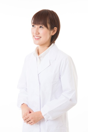 Young woman in a white coat Stock Photo - 16035938