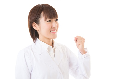 Young woman in a white coat Stock Photo - 16035910
