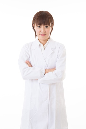 Young woman in a white coat Stock Photo - 16035965
