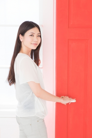 red door and young woman photo