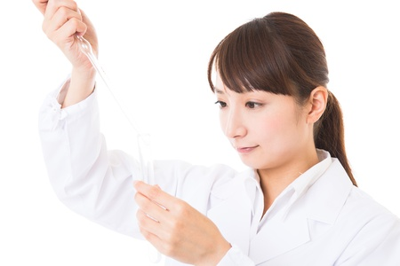 Young woman in a white coat Stock Photo - 16965196
