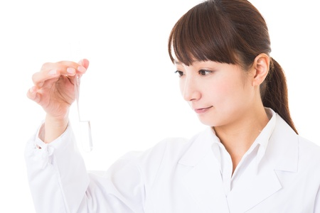 Young woman in a white coat Stock Photo - 16965199