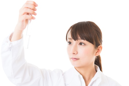 Young woman in a white coat Stock Photo - 16965170