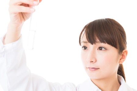 Young woman in a white coat Stock Photo - 16965198