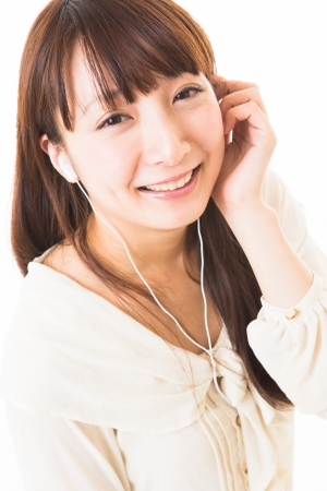 The woman who is relaxed while listening to music photo