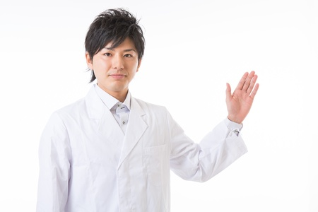 diagnosed: Young man in a white coat Stock Photo