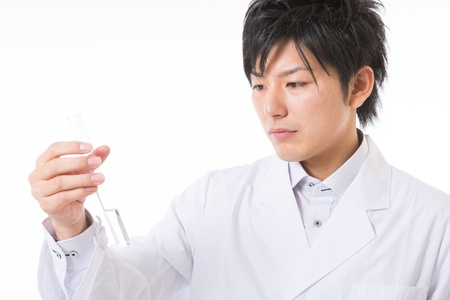 Young man in a white coat Stock Photo - 17255483