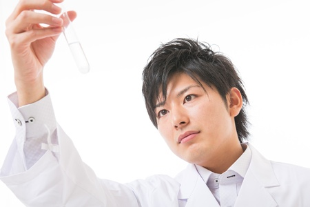 Young man in a white coat Stock Photo - 17255486