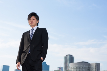 The Young businessman and building photo