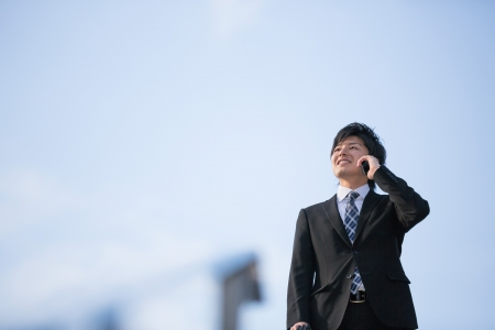 The Young businessman who talks on the telephone photo