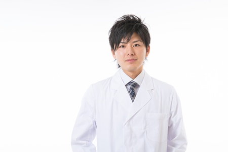 white coat: Young man in a white coat Stock Photo