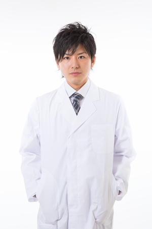 Young man in a white coat Stock Photo - 17255196