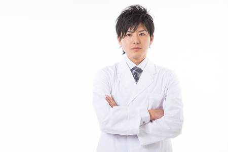Young man in a white coat Stock Photo - 17255170