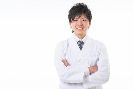 Young man in a white coat