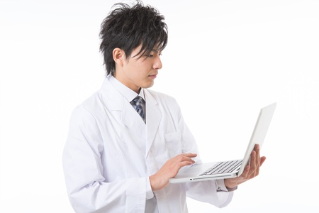 Young man in a white coat Stock Photo - 17255193