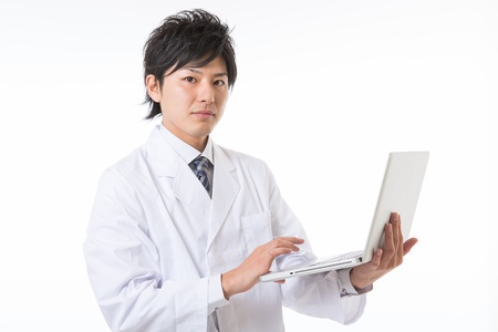 Young man in a white coat 写真素材