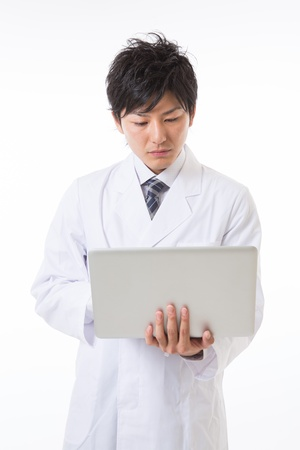 Young man in a white coat Stock Photo - 17255177