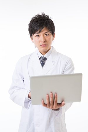 Young man in a white coat Stock Photo - 17255191