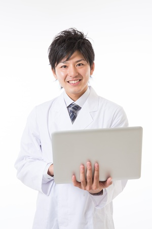 Young man in a white coat Stock Photo - 17255192