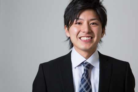 faithfulness: young businessman dressed in the suit Stock Photo