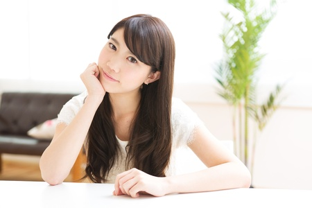 The young woman relaxing in the room Stock Photo - 17843660