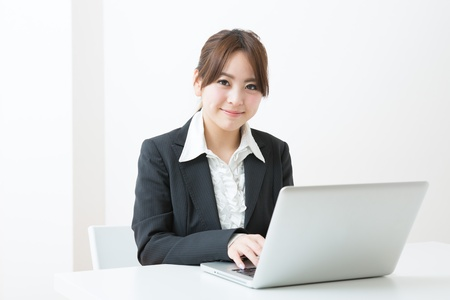 Young businesswoman who uses the computer