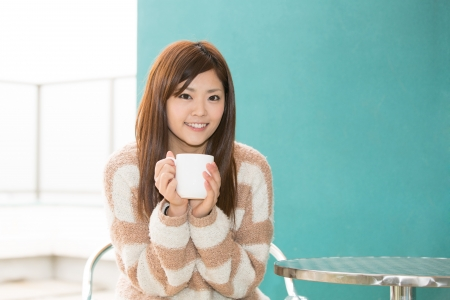 young asian woman relaxing in cafe photo