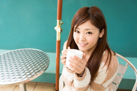 young asian woman relaxing in cafe