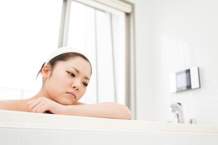 young woman who cries in a bath Stock Photo - 19628528