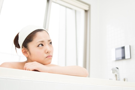 young woman who cries in a bath Stock Photo - 19628525