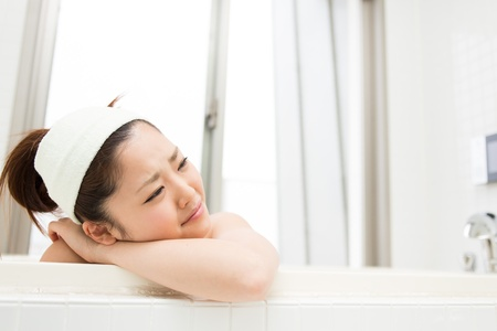 young woman who cries in a bath Stock Photo - 19628538