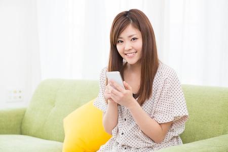 Beautiful young asian woman using smart phone Stock Photo - 19628337