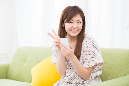 Beautiful young asian woman using smart phone Stock Photo - 19628345