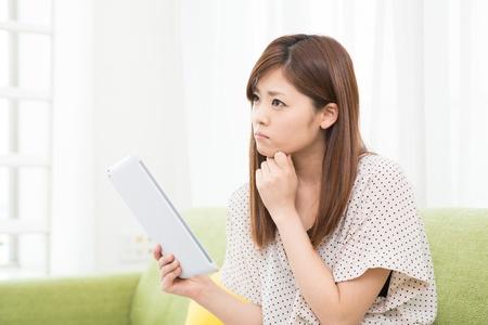 Beautiful young asian woman using tablet computer Stock Photo - 19628313