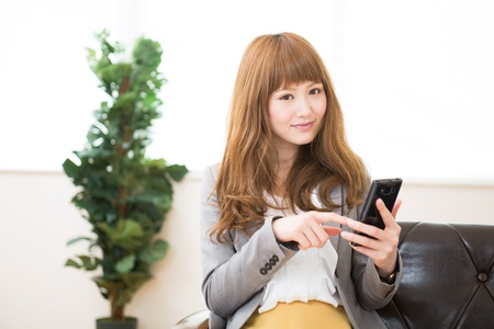 Beautiful young asian businesswoman using a smart phone photo