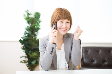 recruit help: The young businesswoman on the phone Stock Photo