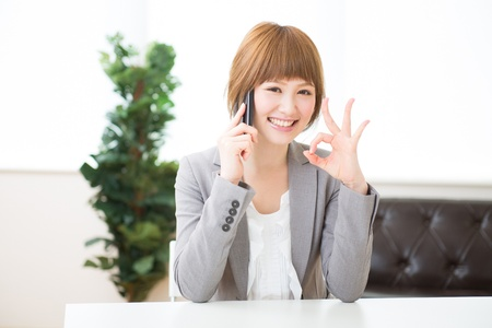 The Young businesswoman who talks on the telephone