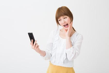Beautiful young asian woman using smart phone Stock Photo - 20072550