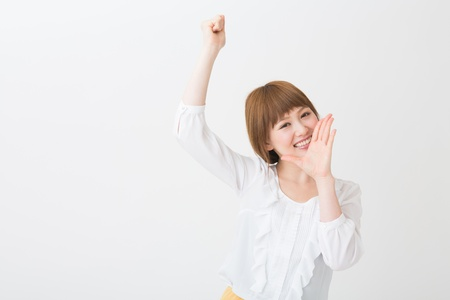 smile please: The young businesswoman who is cheering Stock Photo